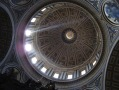 Sun rays light up the dome inside St Peter's Basilica